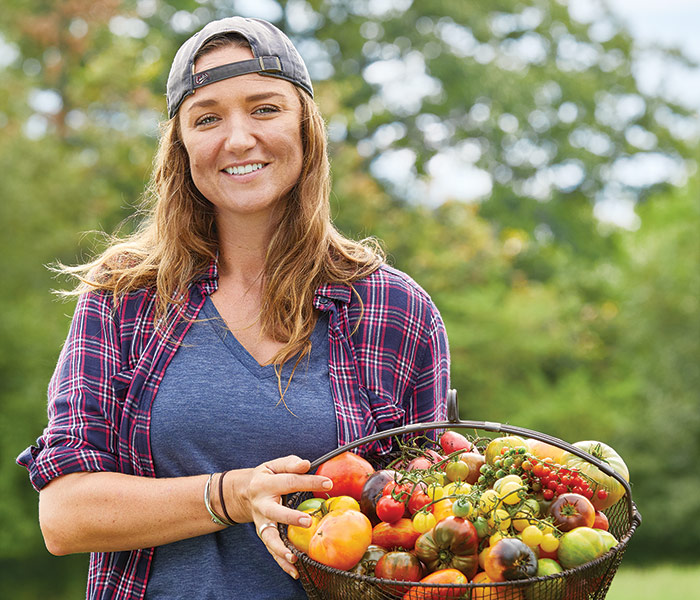 Jennie-smith-butcher-crick-farms-heirloom-tomatoes-portrait: Heirloom tomato grower Jennie Smith of Butcher Crick Farms in Carlisle, Iowa.