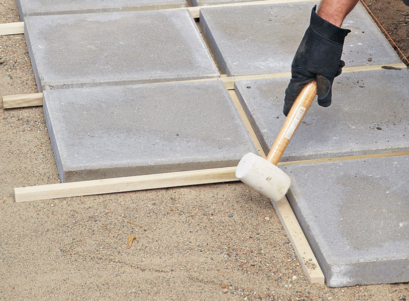 di-how-to-install-patio-step7: A spacer grid makes it easier to keep the patio square.