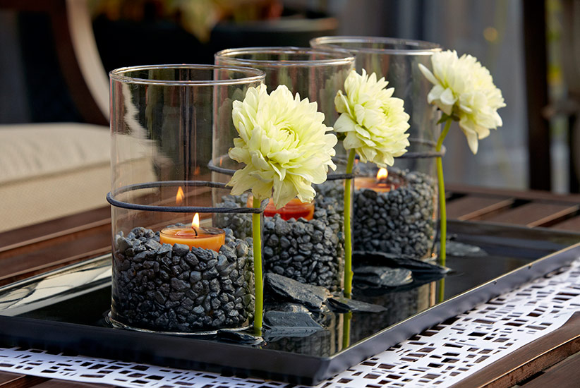 patio-design-idea-tablescape: An elastic hair band secures fresh-cut dahlias to each glass vase.