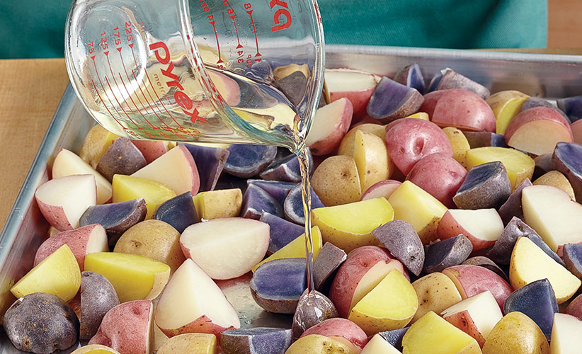 tricolored-potato-salad-recipe-roast-potatoes: Pouring wine over the potatoes while they're warm lets them absorb it and enhances flavor.