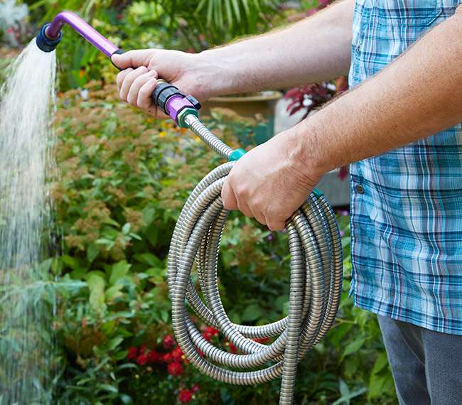 Metal-gardening-hose: It's easy to take this lightweight metal garden hose wherever you need to go in the garden.