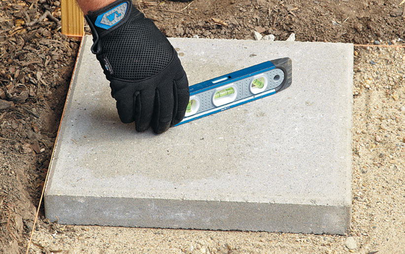 di-how-to-install-patio-step6: Start in one corner of the paver patio and work out from there.