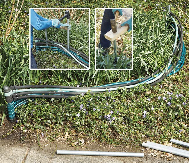 shape edging secure by pounding pipe: Once both ends are set you can begin weaving the additional conduit pipes through the hoses and pounding them in place.