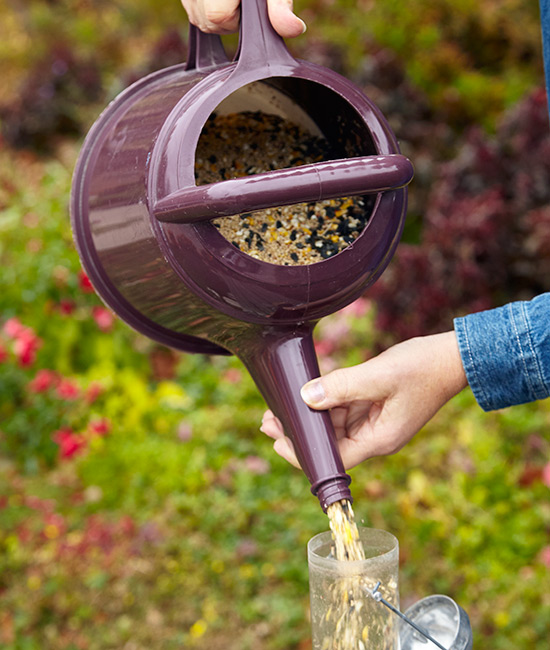 Use a watering can to refill bird feeders: Steady the spout as you pour to be extra sure the seed goes where it's supposed to.