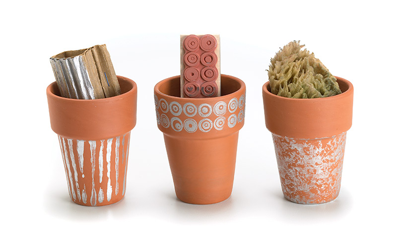 Create-a-childs-garden-personalize-terra-cotta-pots: Personalizing terra-cotta pots with your kids is a fun way to get them involved in the garden.