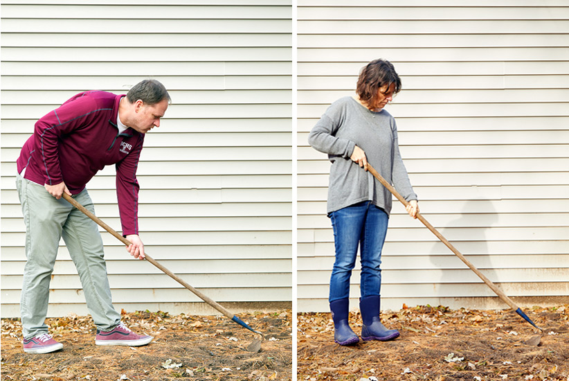 A short person and tall person holding same garden hoe to show posture difference: To hold the same hoe at the correct angle, you can see how a taller gardener, on the left, has to bend over more than a shorter person, on the right, who should grip the hoe further up the handle so it is not awkward to hold.