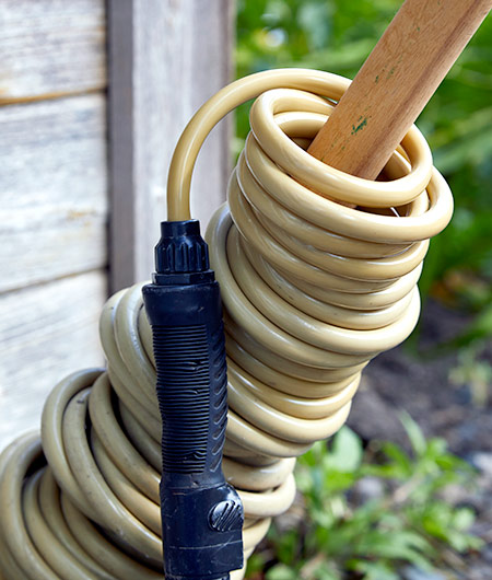 Precoiled polyurethane hose storage tip: Keep the precoiled hose neatly stored by sliding the coils down a length of wood, PVC or a broom handle.