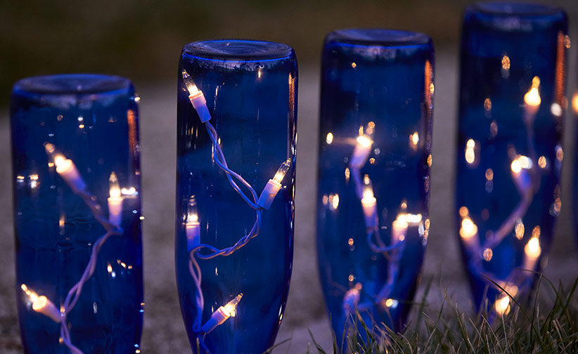 How to make wine bottle garden lights | Garden Gate Icicle Holiday Lighting Ideas on icicle photography, led christmas lights ideas, icicle christmas, string lights ideas, christmas trees ideas,
