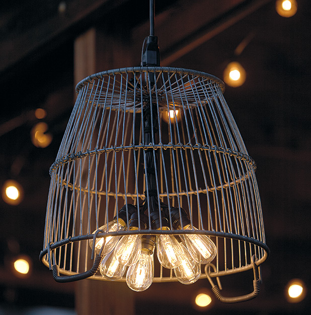 di-garden-chandelier-lead: A metal basket becomes a light shade and adds a touch of farmhouse chic.