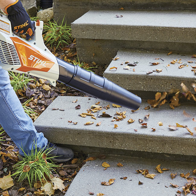 battery-powered-leaf-blower-in-action: Lightweight and cordless, you can go anywhere with this leaf blower.