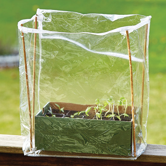 ht-ss-successfully-start-seeds-4: Bamboo stakes give structure to the sides of the bag, and cardboard holds the bottom open and flat.