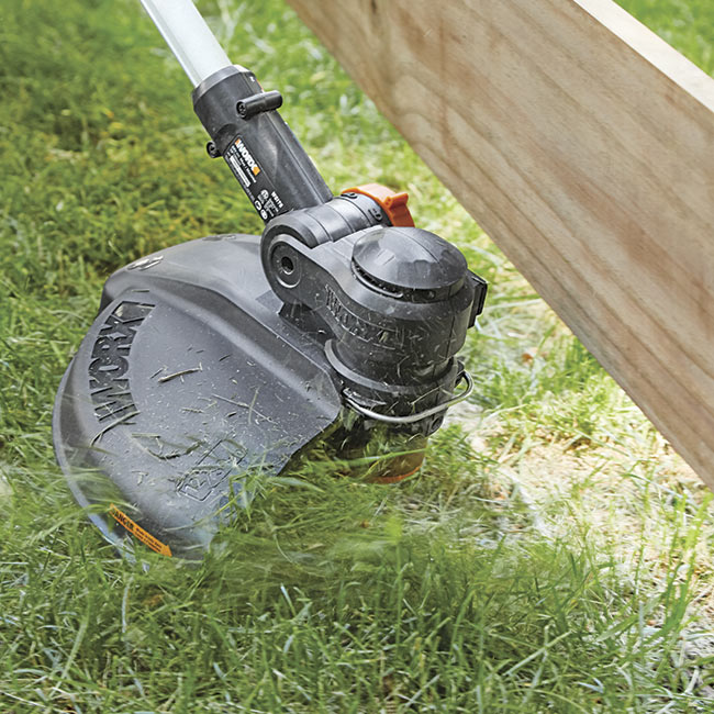 battery-powered-string-trimmer-in-action: WORX batteries can be swapped out for other WORX tools.