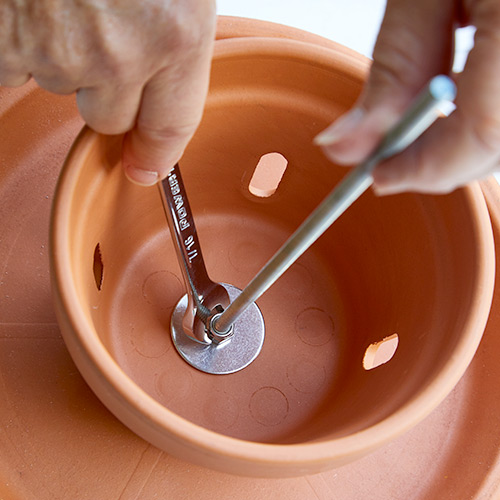 how-to-make-terra-cotta-birdfeeder-tighten-lock-nut-with-crescent-wrench: A longer handled crescent wrench makes this step easier.