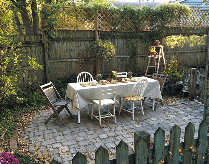 budget-friendly-garden-seating-areaR:  Add extra privacy with a panel of lattice attached to the top of a privacy fence.