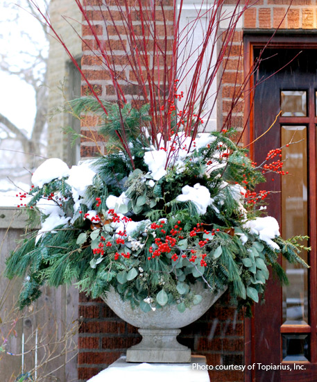 winter-garden-outdoor-arrangement: A seasonal arrangment of evergreens looks beautiful even with a layer of snow!