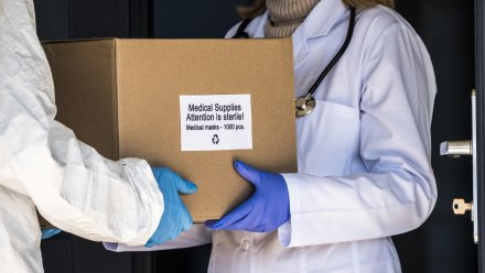 Medical Staff passing a box