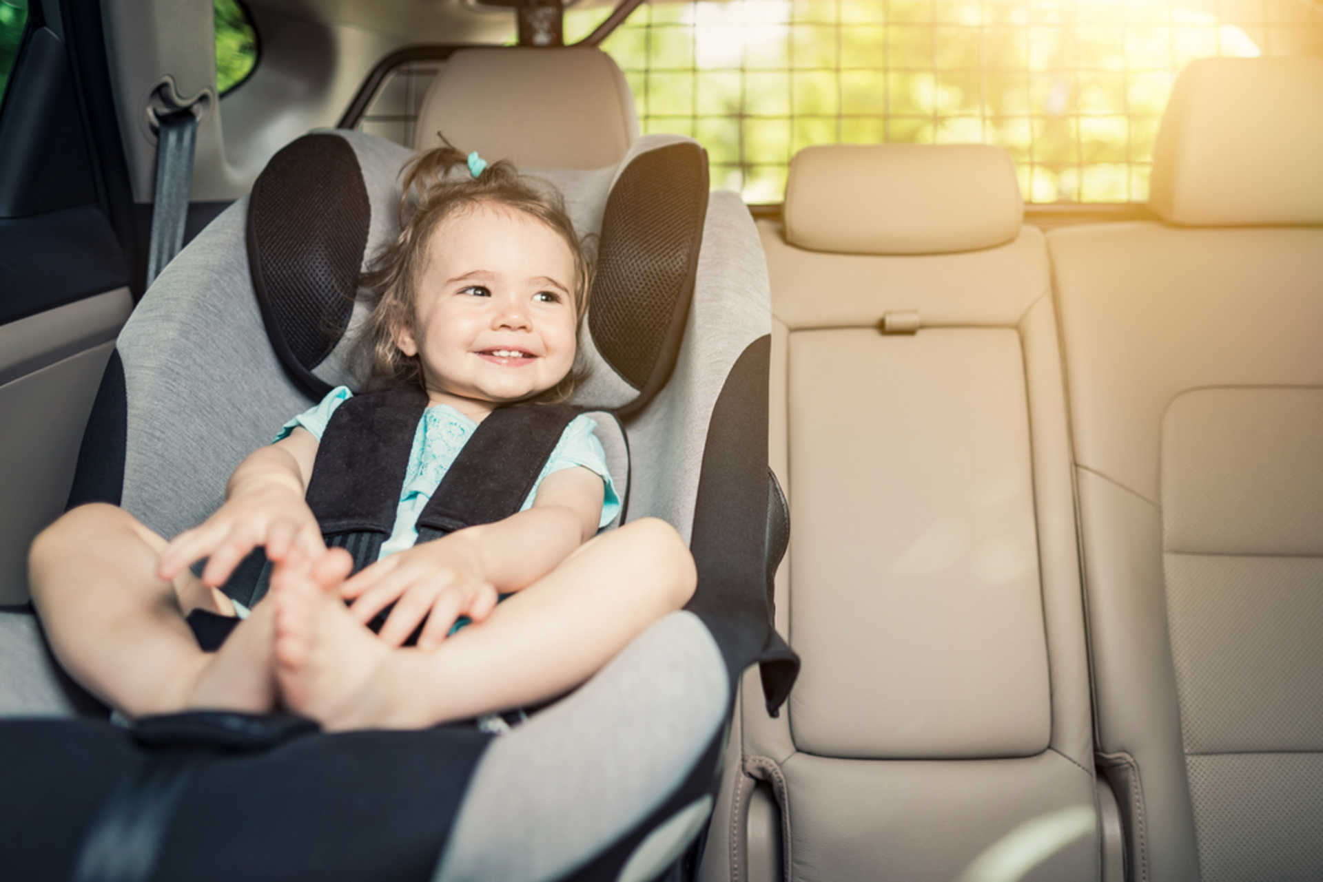 stock-photo-beautyful-smiling-baby-girl-fastened-with-security-belt-in-safety-car-seat-693112123