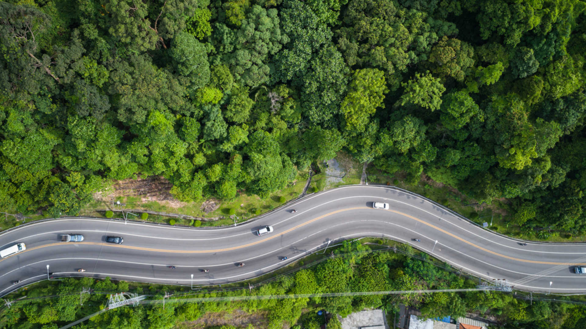 stock-photo-top-view-car-and-road-on-the-hill-in-phuket-thailand-aerial-view-from-flying-drone-633127292