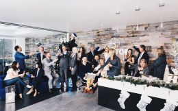Action shot of Lockton employees celebrating in office