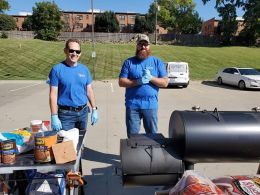 Two Men with Lockton shirts grilling
