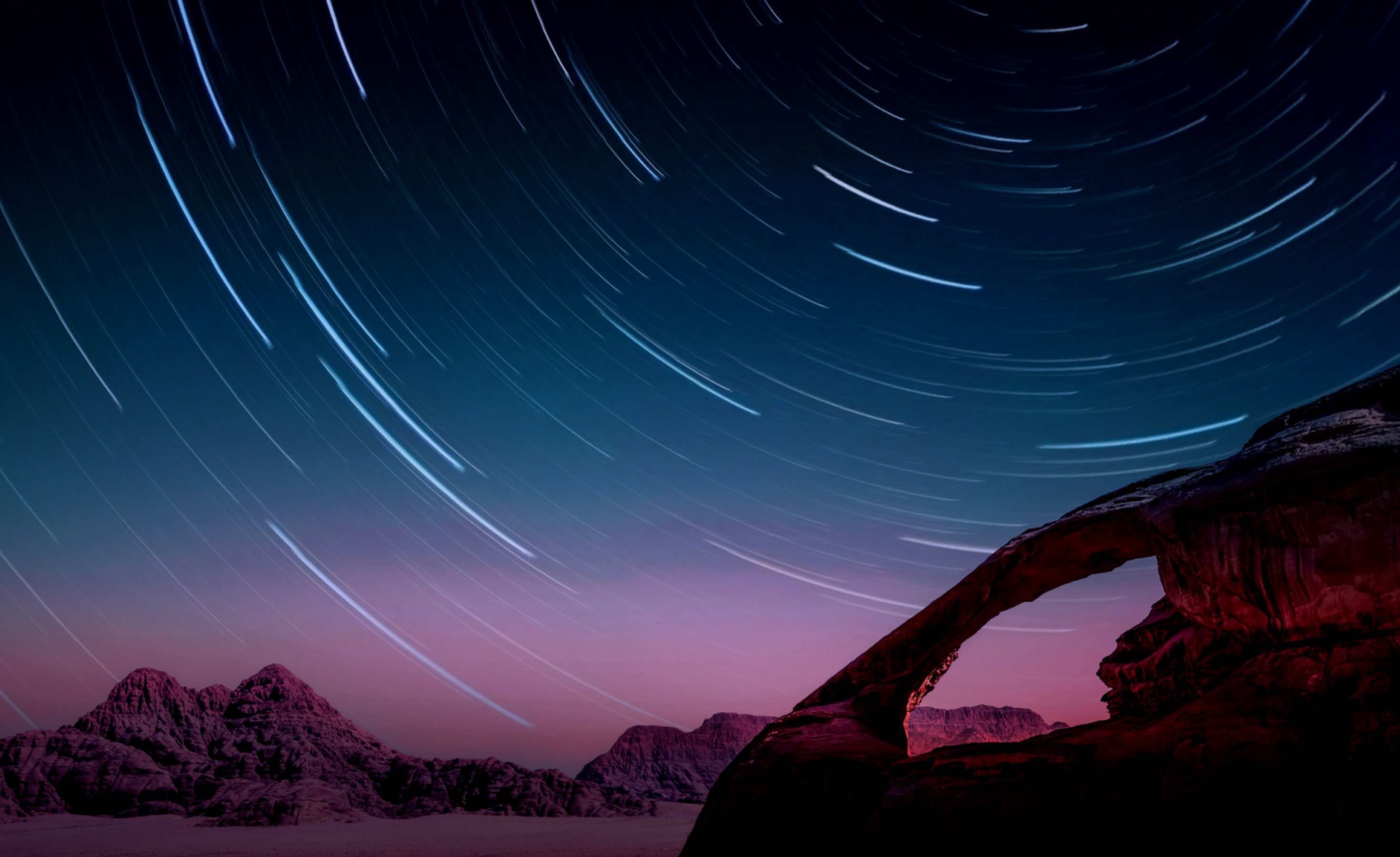 Image of mountains at dusk with stars