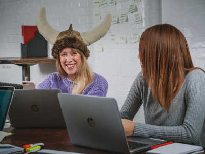 Office worker wearing a viking hat