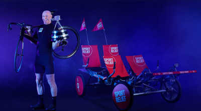 Gareth Thomas posing with two bikes