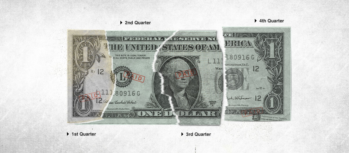 American dollar bill torn into four pieces