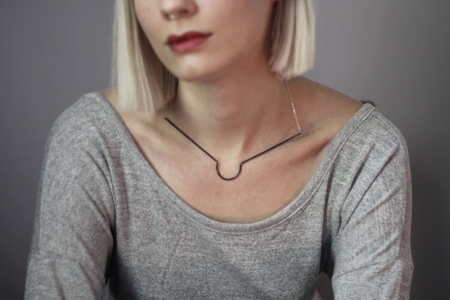 H Works jewelry - photo of necklace on woman