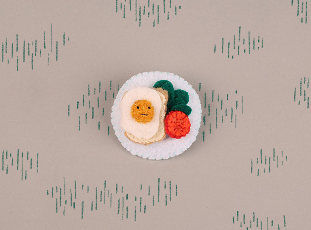 Brooch made from fabric featuring breakfast items