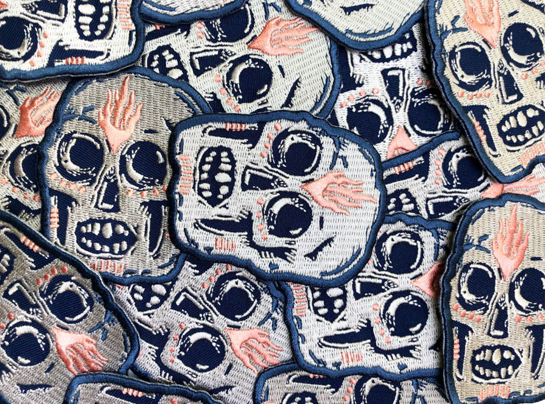 Patch of a skull with flames