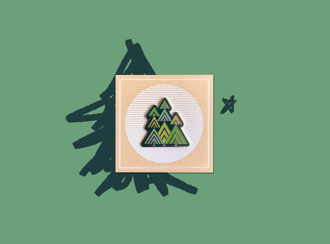 Enamel pin of abstract trees