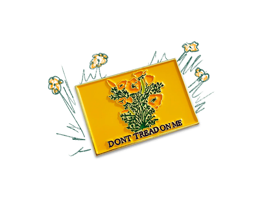 Enamel pin with a loose illustration of California poppies and the words don't tread on me