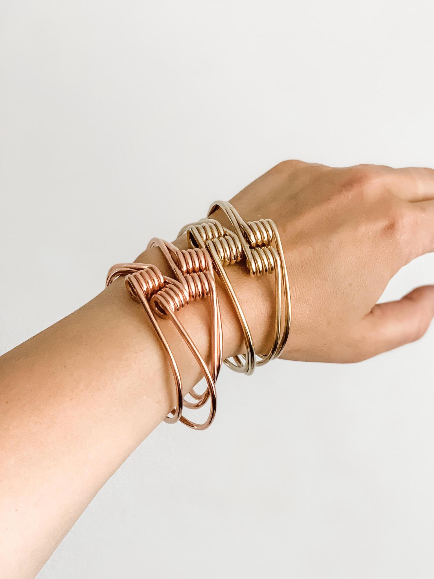 H Works jewelry - photo of two bracelets on arm