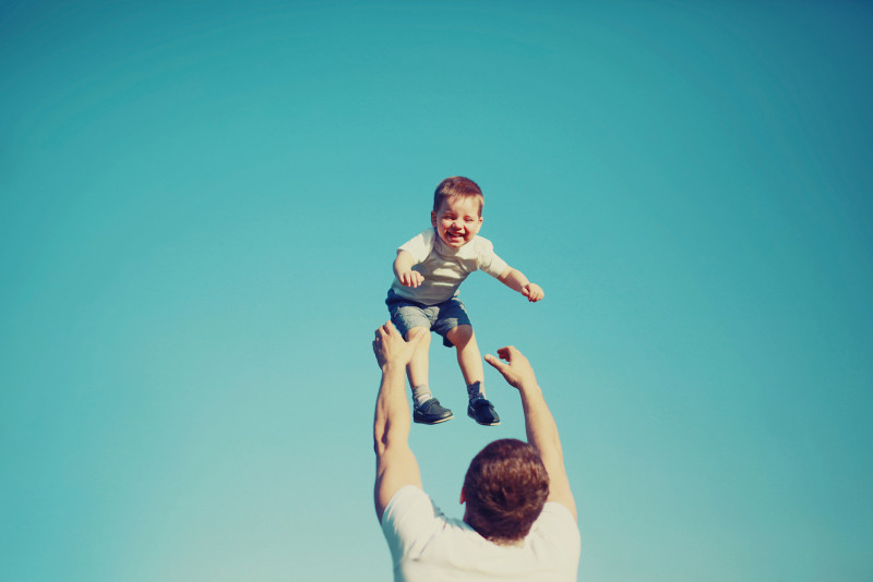 happy-father-and-child-having-fun-outdoors