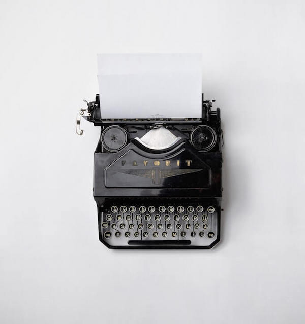 A vintage type writer on a white background.